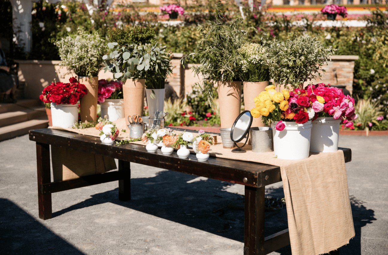 Boutineer bar table set with flowers and foliage.