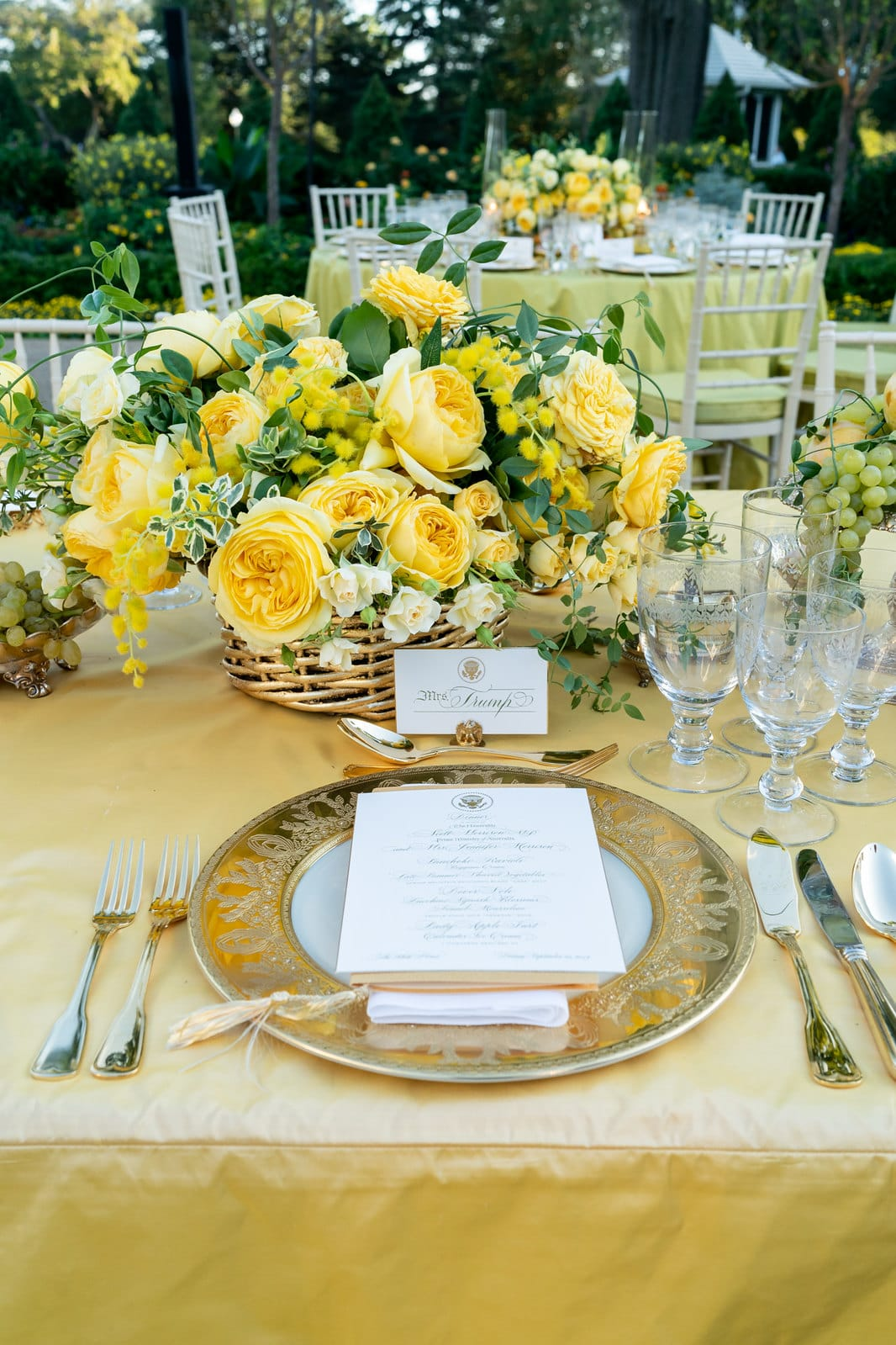 View of dinner plate setting on table with flowers.